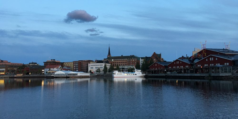 lake and buildings in small city in Sweden, Lulea.