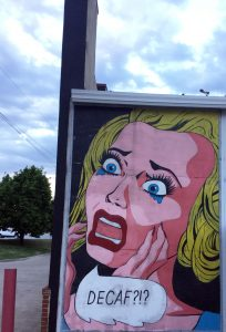 Street mural of woman crying for coffee in Fayetteville, Arkansas