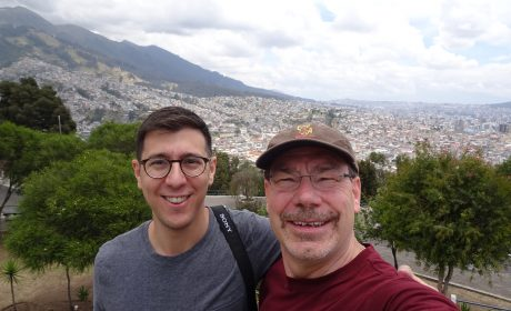 Jonathan Alba and Gregory Pogue standing in front of a mountainous area
