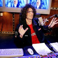 Howard Stern sitting in his studio