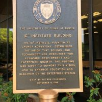 The IC2 Institute building is sign says it established the vision that science and technology are resources for economic development and enterprise growth.