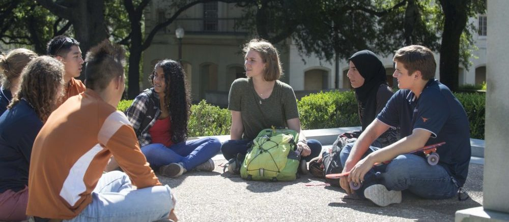 A group of students sitting in a circle