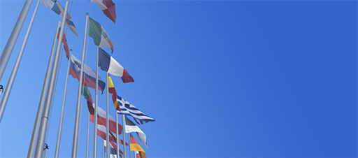 EU nation flags against blue sky