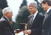 George Kozmetsky accepting the National Medal of Technology from President Clinton (1993)
